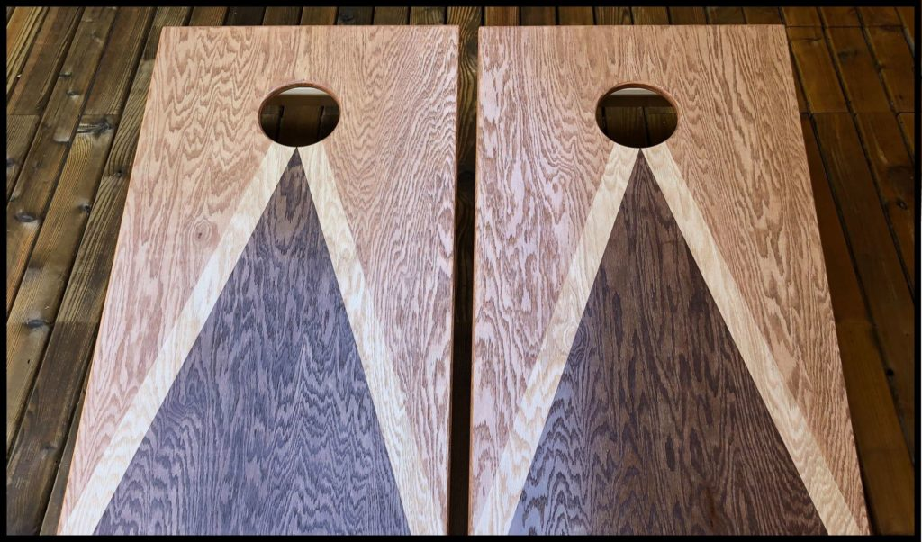 in house artwork corn hole boards with stain
