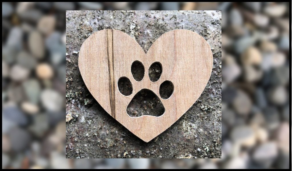 paw in heart cut out of wood