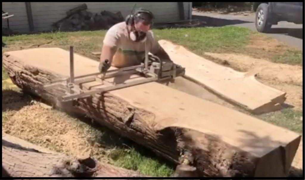 man milling log